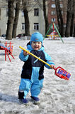 Little boy plays at playground in wintertime with toy Royalty Free Stock Photos