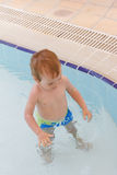 Little boy plays in the pool royalty free stock photo