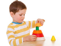 Little boy plays with a pyramid Stock Photography