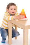 Little boy plays with a pyramid Royalty Free Stock Photos