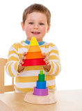 Little boy plays with a pyramid Stock Photo