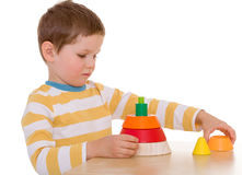 Little boy plays with a pyramid Royalty Free Stock Photography