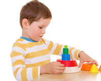 Little boy plays with a pyramid Royalty Free Stock Photo