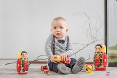 Little boy plays with Russian nested doll. The little boy plays with Russian nested doll Royalty Free Stock Photos