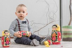 little boy plays with Russian nested doll stock image