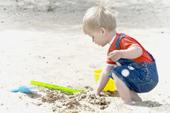 A little boy plays sand Royalty Free Stock Photography