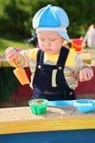 Little boy plays in sandbox Royalty Free Stock Photo