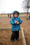 Little boy plays in a sandbox on playground Royalty Free Stock Photography