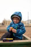 Little boy plays in a sandbox on playground Royalty Free Stock Images