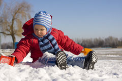 Little boy plays snow Royalty Free Stock Image
