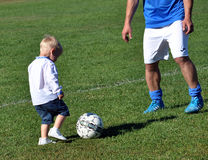 Little boy plays with a soccer ball_5 Stock Images