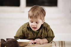 Little boy plays at a table Royalty Free Stock Images