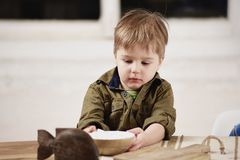 Little boy plays at a table Stock Image