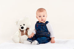 The little boy plays with a teddy bear Stock Image