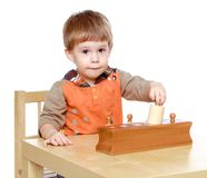 Little boy plays to develop Stock Image