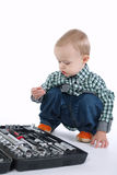 Little boy plays with tools case Royalty Free Stock Image