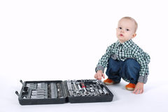 Little boy plays with tools case Royalty Free Stock Images