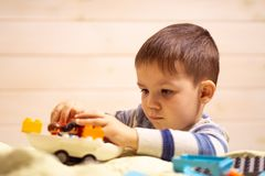 Little boy plays with toy car at home royalty free stock images