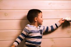 Little boy plays with toy car at home stock images