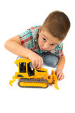 Little boy plays with toy tractor Royalty Free Stock Photo