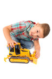 Little boy plays with toy tractor Stock Photos