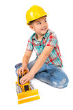 Little boy plays with toy tractor Royalty Free Stock Image