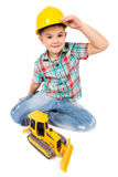 Little boy plays with toy tractor Royalty Free Stock Images