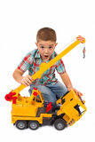 Little boy plays with toy truck Royalty Free Stock Photography