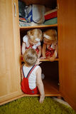 Little boy plays with twins stock image