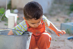 Little boy plays with water Stock Photo
