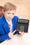 Little boy pointing at the calculator Stock Images