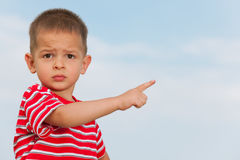 Little boy pointing direction Stock Photos