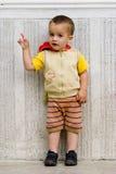 Little boy pointing finger Stock Images