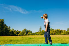 Little Boy Pointing At Flying Plane In Blue Summer Royalty Free Stock Images
