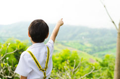 Little boy pointing his finger to the sky Stock Photography