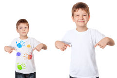 Little boy pointing his fingers on a white t-shirt. Happy little boy pointing his fingers on a clean t-shirt, and sad little boy pointing his fingers on a dirty Stock Photos