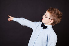Little boy pointing out with a finger Royalty Free Stock Photography