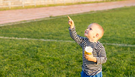 Little boy pointing at the sky Stock Images