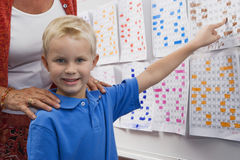 Little Boy Pointing To A Calendar Date For Teacher Royalty Free Stock Image