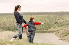 Little boy pointing to something in the country. Little boy pointing to something  countryside showing his mother point  interest as they stand together on top Stock Photography