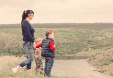 Little boy pointing to something in the country. Little boy pointing to something countryside showing his mother point  interest as they stand together top Royalty Free Stock Photos