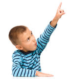 Little boy is pointing up using his index finger Royalty Free Stock Image