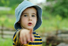 Little boy points to the camera Royalty Free Stock Photos