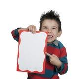 Little boy points whiteboard Royalty Free Stock Photos