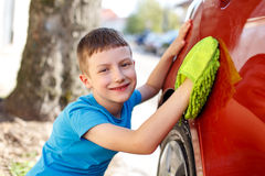 Little boy polish red car Royalty Free Stock Photo