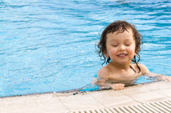 Little boy in pool stock images