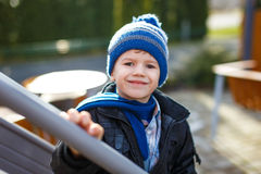 Little boy in pompon cap at winter Stock Images