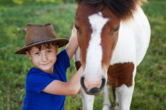 Little boy with pony Royalty Free Stock Photo