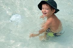 Little boy in the pool Royalty Free Stock Images