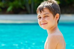 Little boy by the pool Stock Image